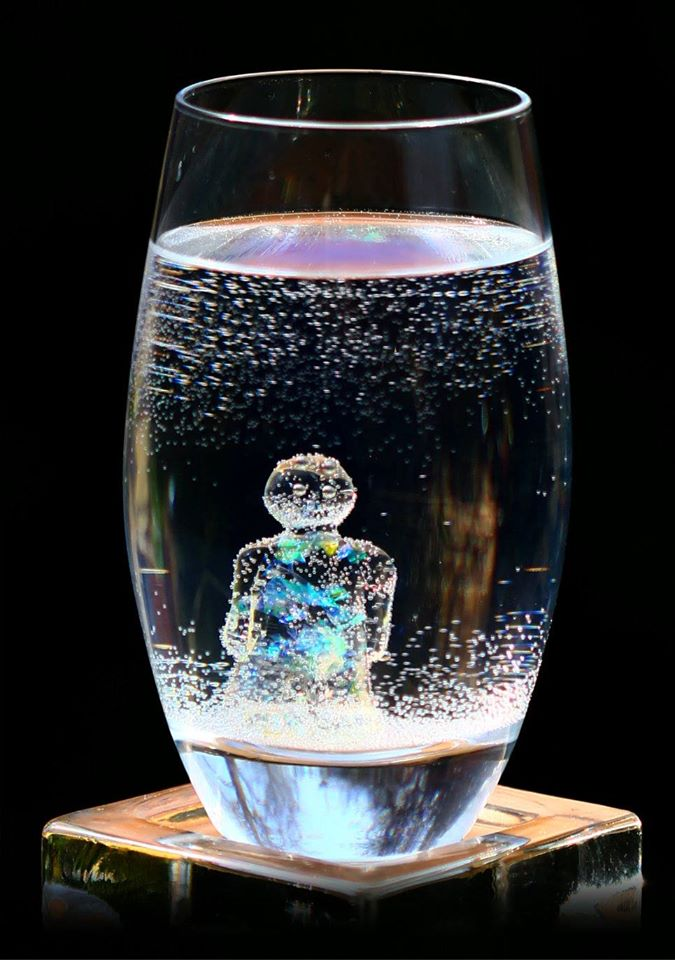 Mens in sparkling mineral water with bubbles