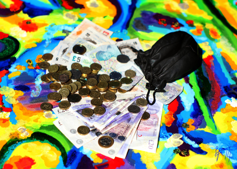 Money coins and money notes on an abstract painting - Photograph by Silvia Hartmann, April 9th, 2014