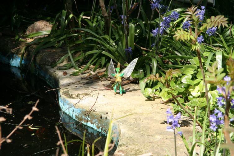 Green Fairy by the garden pond
