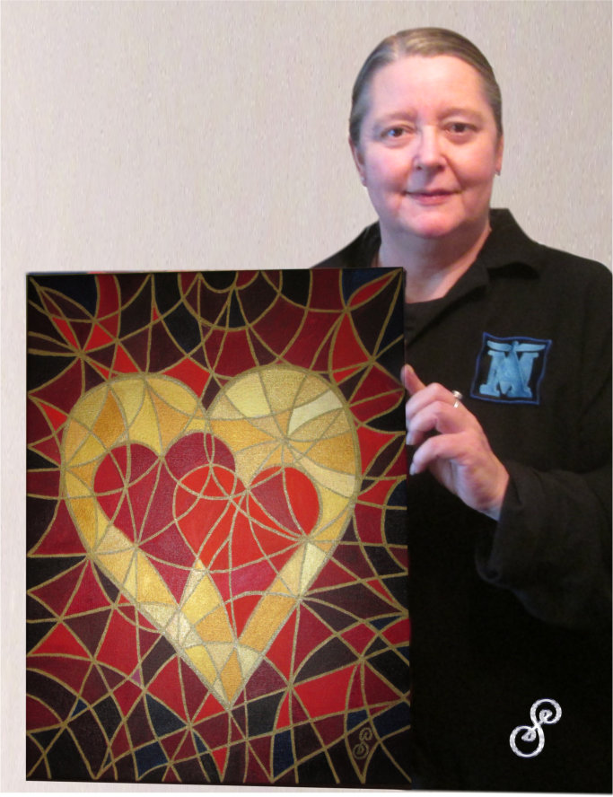 "Silvia Hartmann with ""Make Love Your Goal"" painting"