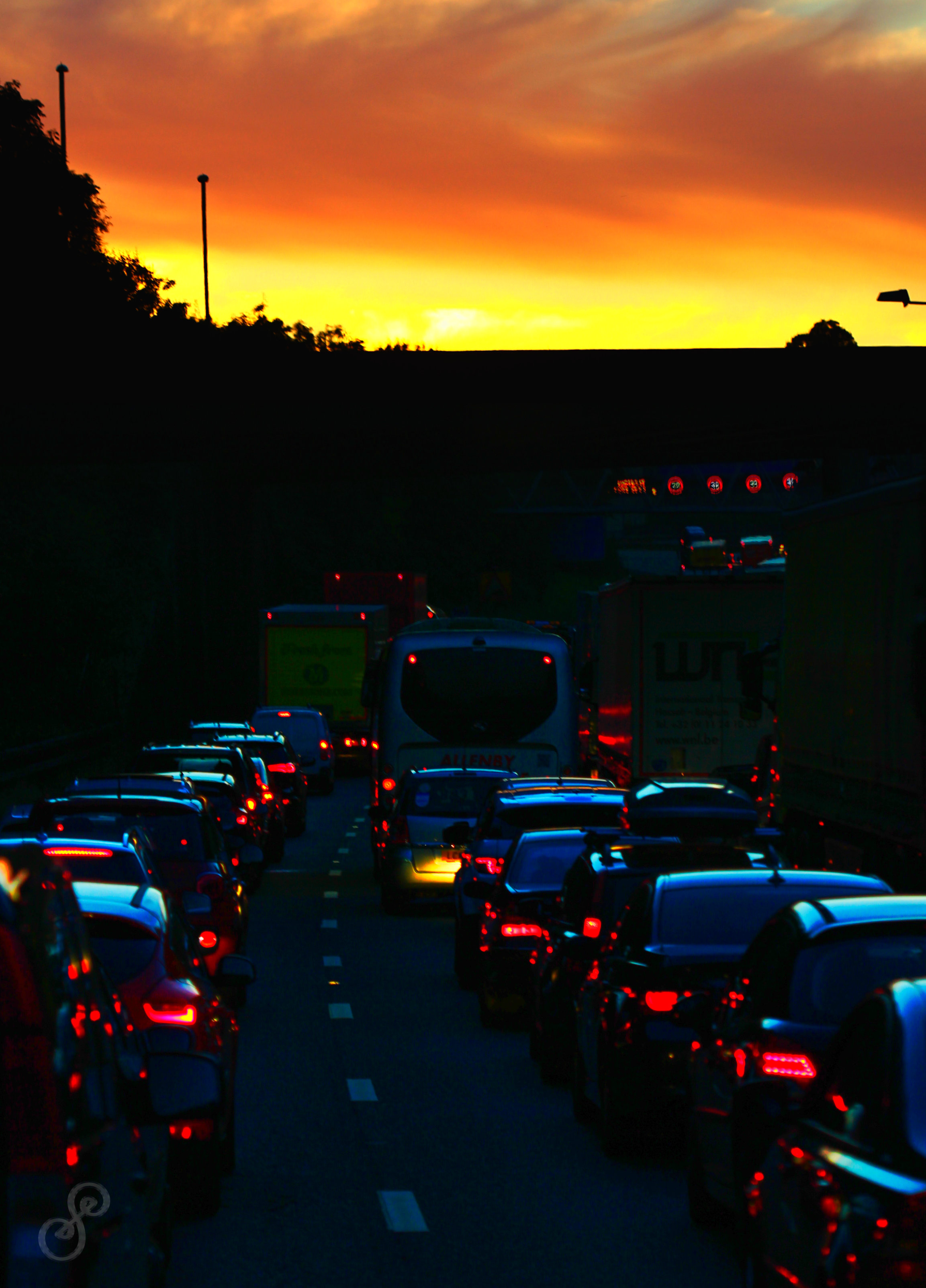 Cars queing at sunset on a motorway to get home