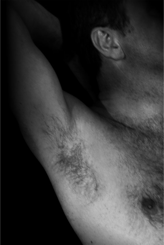 Black and white photograph of a man's chest
