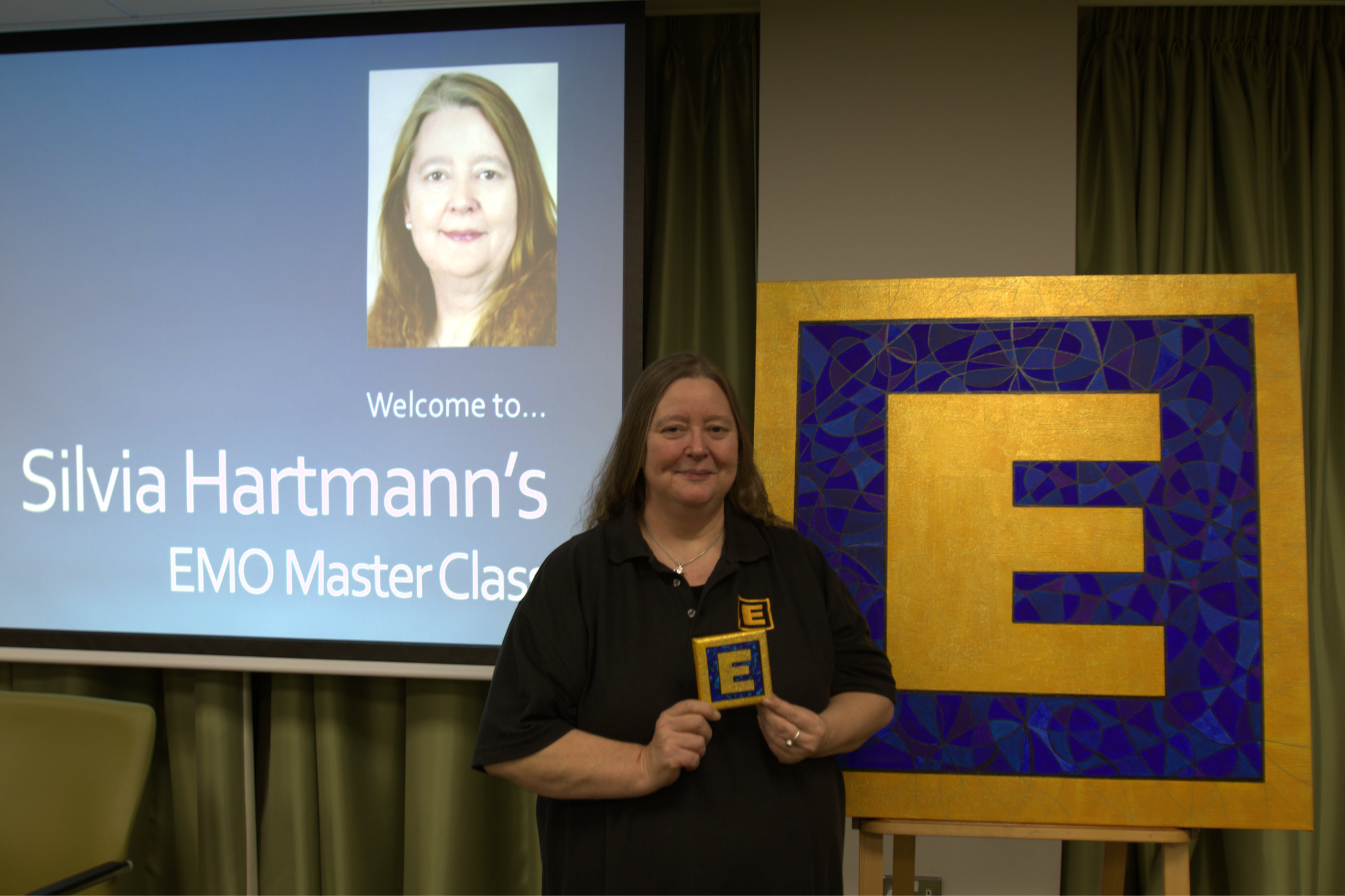 Silvia Hartmann with Big E and Little E paintings before the EMO Masterclass
