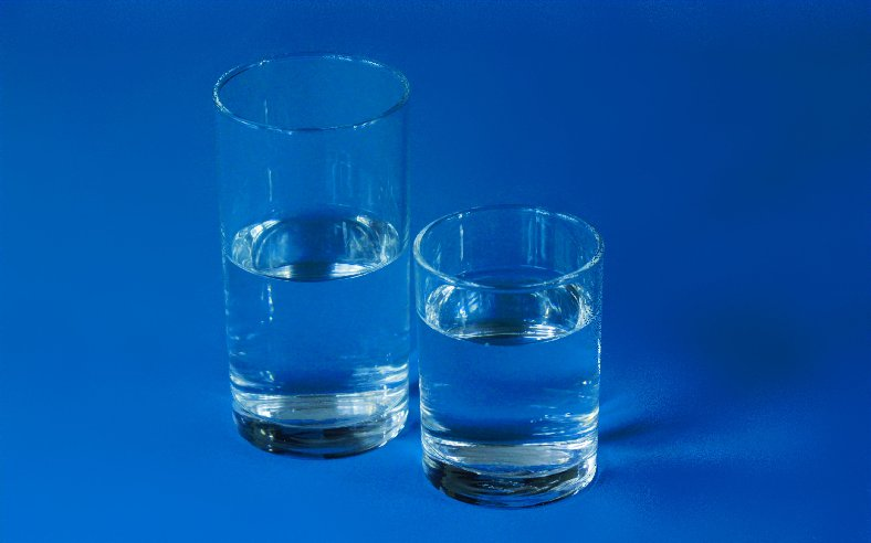 Two glasses of water on a deep blue background