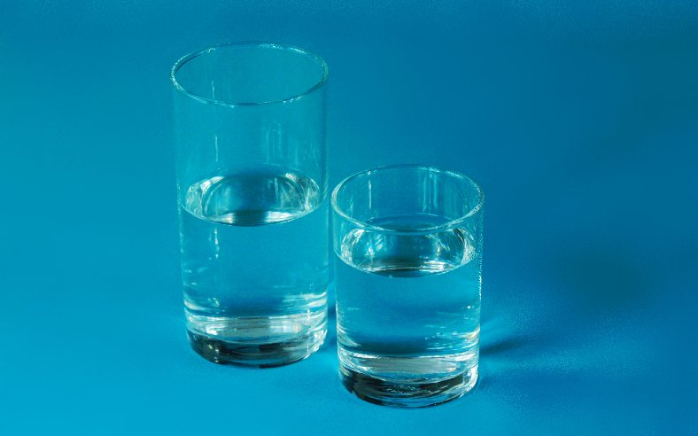 Two glasses of water on a bluish background