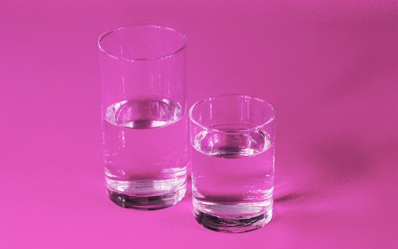 Two glasses of water on a pink background